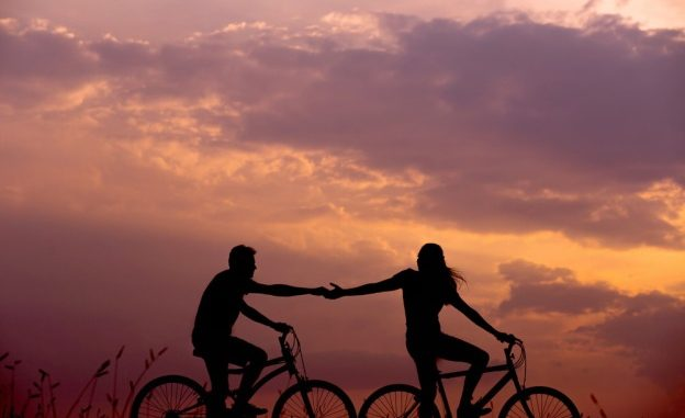 a couple on bikes at twilight